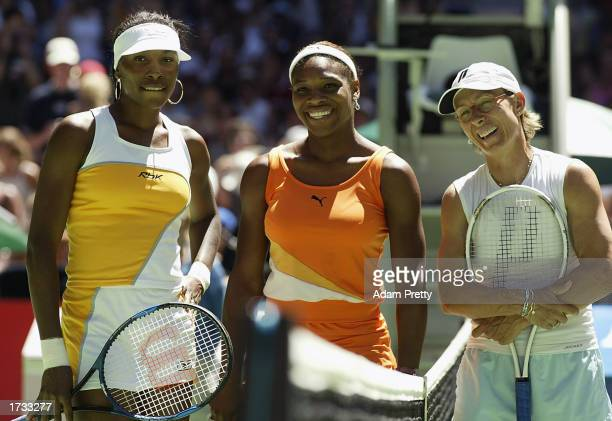 Venus and Serena Williams of the USA line up with Martina Navratilova of the USA before their Womens Doubles game during the Australian Open Tennis...