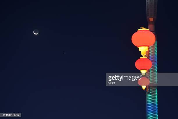 Venus appears in the night sky near a crescent moon on October 14, 2020 in Korla, Xinjiang Uygur Autonomous Region of China.
