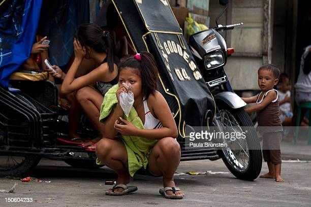 Venus inhales glue mixed with nail polish remover in a plastic bag living in the slums of Binondo August 20 2012 in Manila Philippines Venus ran away...