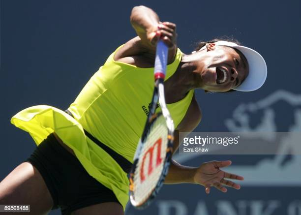 Venus Wiliiams serves to Marion Bartoli of France during the first set of their final match at the Bank of the West Classic August 2, 2009 in...