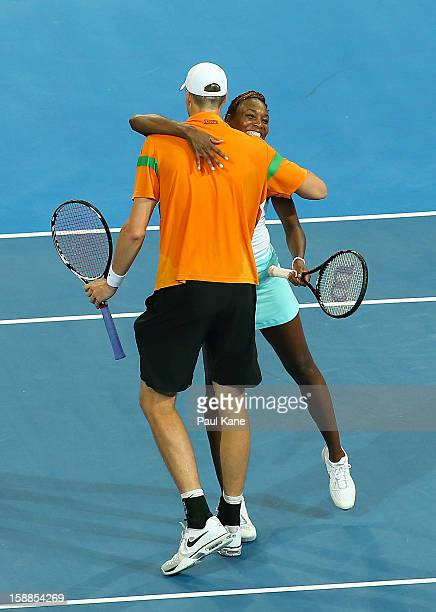 Venus Williams and John Isner of the USA celebrate defeating Mathilde Johansson and Jo Wilfried Tsonga of France in the mixed doubles match during...