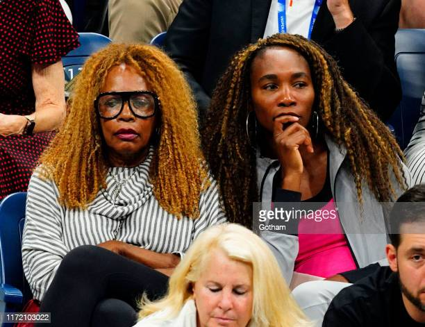Venus Williams and Oracene Price cheer on Serena WIlliams and Roger Federer at the 2019 US Open on September 03 2019 in New York City