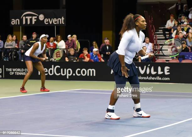 Venus Williams and Serena Williams of Team USA wait on a serve from Lesley Kerkhove and Demi Schuurs of the Netherlands in a doubles match during the...