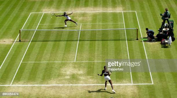 Venus Williams and Serena Williams of the United States in action during the ladies singles semi final match on Centre Court during the Wimbledon...