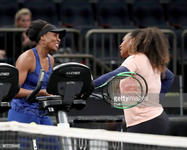 Venus Williams and Serena Williams of the United States talk after they practiced during the Tie Break Tens at Madison Square Garden on March 5 2018...