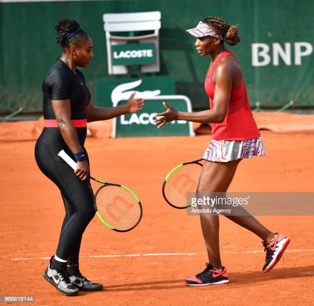 Venus Williams and Serena Williams of the USA in action against Andreja Klepac of Slovenia and Maria Jose Martinez Sanchez of Spain during during...