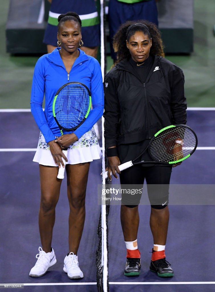 Venus Williams and Serena Williams pose for a photo before their match against each other during the BNP Paribas Open at the Indian Wells Tennis Garden on March 12, 2018 in Indian Wells, California.