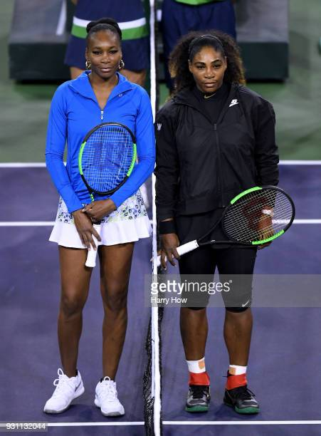 Venus Williams and Serena Williams pose for a photo before their match against each other during the BNP Paribas Open at the Indian Wells Tennis...