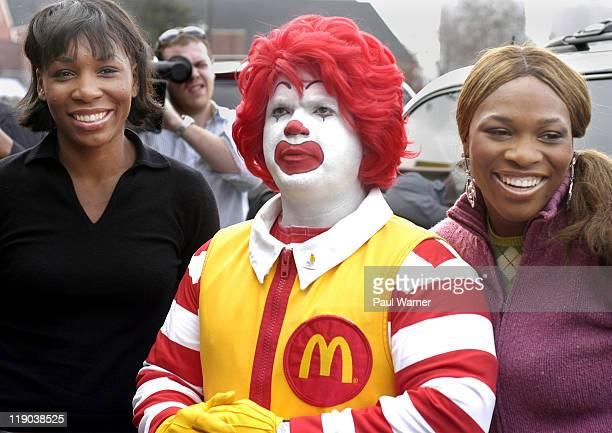 Venus Williams and Serena Williams pose with Ronald McDonald