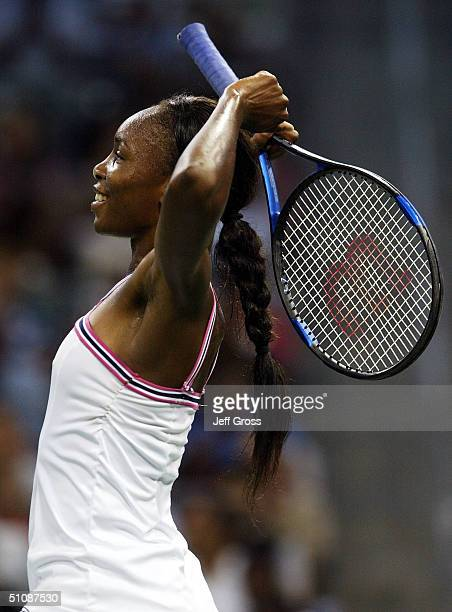 Venus Williams celebrates following her 62 61 victory over Ashley Harkleroad during the second round of the JP Morgan Chase Open on July 20 2004 at...