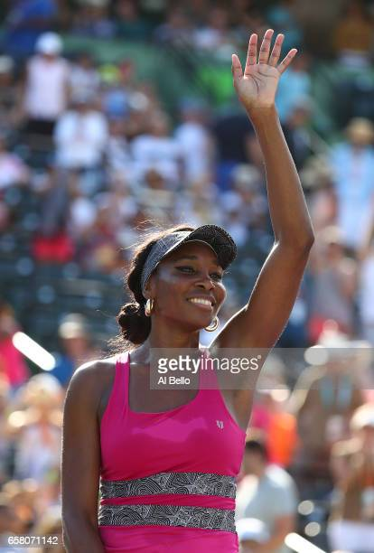 Venus Williams celebrates match point against Patricia Maria Tig of Romania during Day 7 of the Miami Open at Crandon Park Tennis Center on March 26...