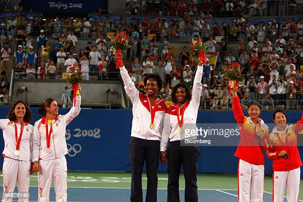 Venus Williams center left and Serena Williams center right both of the US Virginia Ruano Pascual left and Anabel Medina Garrigues both of Spain and...