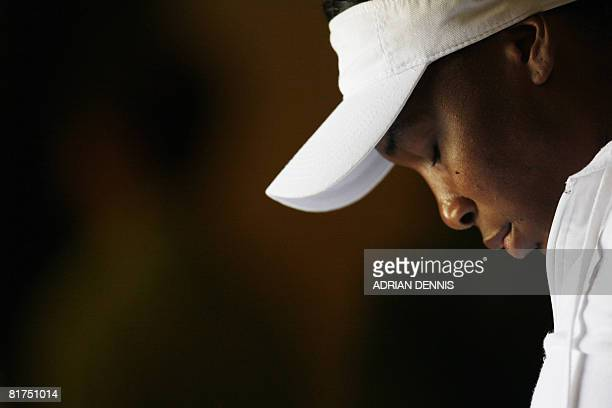 Venus Williams concentrates prior to enter court 1 to play against her Spanish opponent Maria Jose Martinez Sanchez during their 2008 Wimbledon...