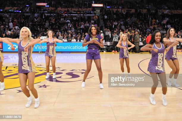 Venus Williams dances with the Laker Girls during halftime at a basketball game between the Los Angeles Lakers and the Oklahoma City Thunder at...