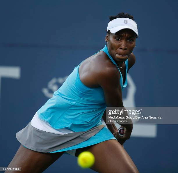 Venus Williams eyes a backhand shot against Alison Riske in the second set during the semifinals of the Bank of the West Classic women's tennis...