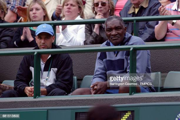 Venus Williams' father and coach Richard Williams and her trainer Terrie Brooks watch the action