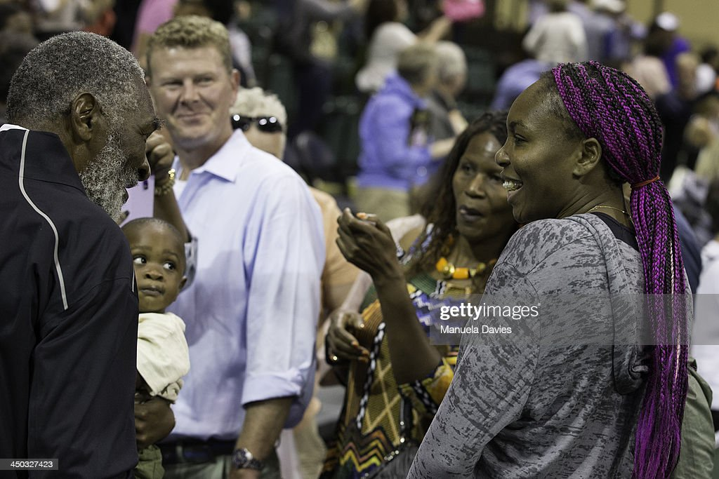 Venus Williams greets her father Richard Williams and half-brother Dylan Williams during the 2013 Mylan WTT Smash Hits on November 17, 2013 at the ESPN Wide World of Sports Complex in Lake Buena Vista, Florida.