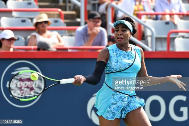 Venus Williams hits a return against Caroline Dolehide during day one of the Rogers Cup at IGA Stadium on August 6 2018 in Montreal Quebec Canada
