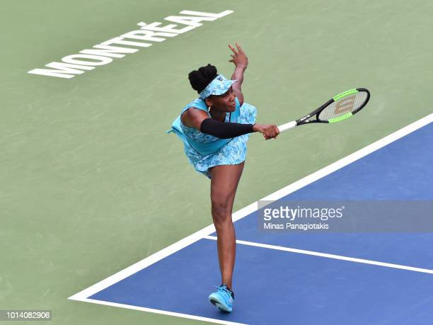 Venus Williams hits a return against Sorana Cirstea of Romania during day four of the Rogers Cup at IGA Stadium on August 9 2018 in Montreal Quebec...