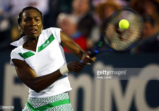 Venus Williams hits a return during her match against MarieGayanay Mikaelian of Switzerland during the Family Circle Cup on April 15 2004 at the...