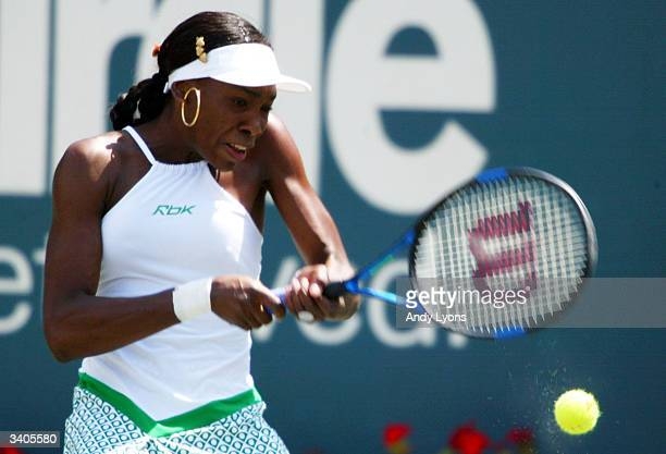 Venus Williams hits a return during her match against Vera Zvonareva of Russia on April 16 2004 during the Family Circle Cup at the Family Circle...