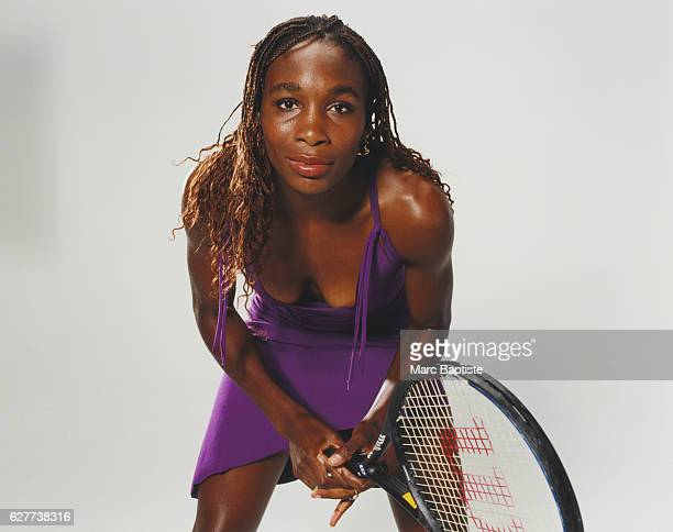 Venus Williams in Purple Dress with Tennis Racket