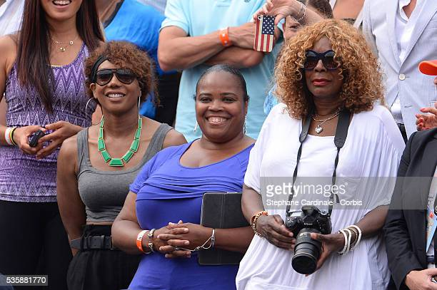 Venus Williams Isha Price and Oracene Price the mother of Serena Williams of United States of America looks on after her Women's singles final match...