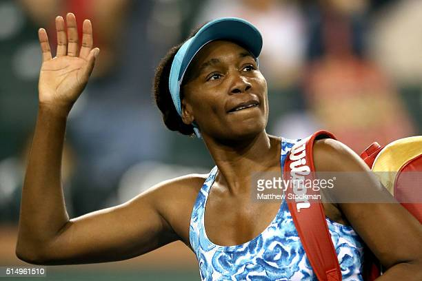 Venus Williams leaves the court after losing to Karumi Nara of Japan during the BNP Paribas Open at the Indian Wells Tennis Garden on March 11 2016...