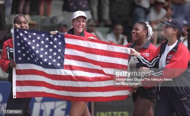 SIMON Venus Williams Lindsey Davenport Serena Williams and Monica Seles walk around the Taube Family Tennis Stadium with the American flag after...