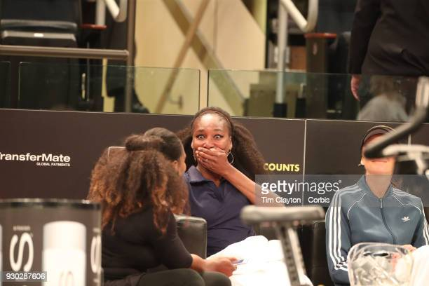 Venus Williams of the United States and her sister Serena Williams of the United States share a moment during the Tie Break Tens Tennis Tournament at...