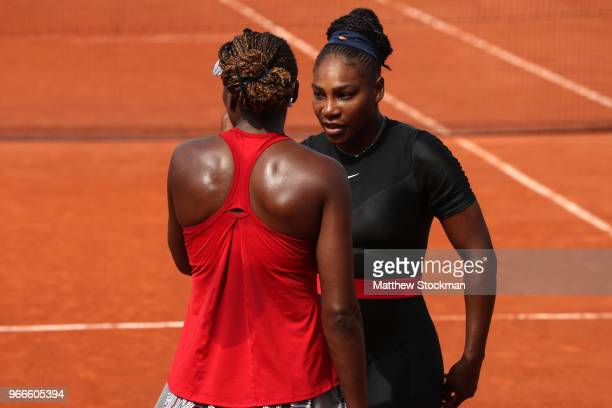 Venus Williams of The United States and partner Serena Williams in conversation during their ladies doubles fourth round match againstAndreja Klepac...