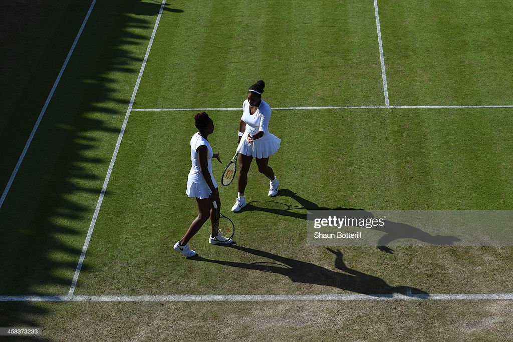 Venus Williams of The United States and Serena Williams of The United States in conversation during the Ladies doubles first round match against Elise Mertens of Belgium and An-Sophie Mestach of Belgium on day six of the Wimbledon Lawn Tennis Championships at the All England Lawn Tennis and Croquet Club on July 2, 2016 in London, England.