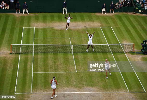 Venus Williams of The United States and Serena Williams of The United States celebrate victory in the Ladies Doubles Final against Timea Babos of...