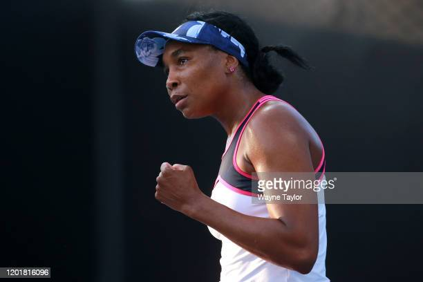 Venus Williams of the United States celebrates a point and during her Mixed Doubles first round match with partner Juan Sebastian Cabal of Colombia...