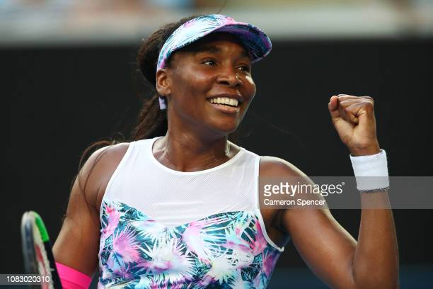 Venus Williams of the United States celebrates after winning match point in her first round match against Mihaela Buzarnescu of Romania during day...