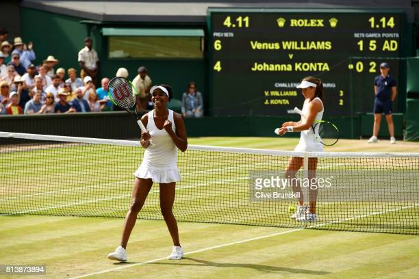 Venus Williams of The United States celebrates victory as Johanna Konta of Great Britain looks dejected during the Ladies Singles semi final match on...