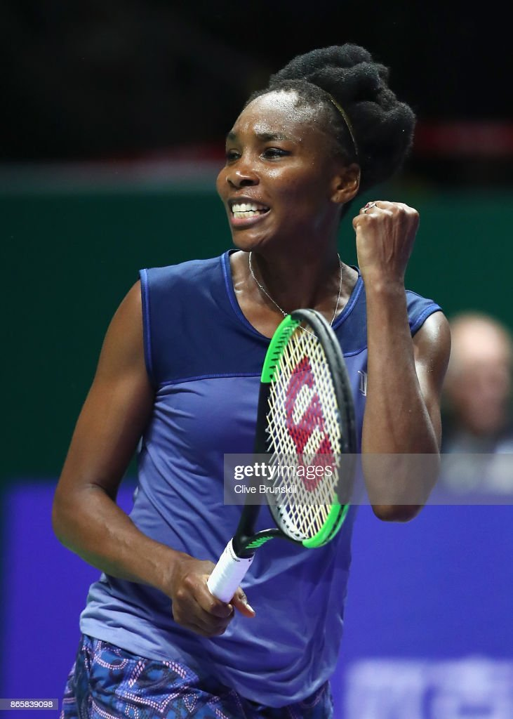 Venus Williams of the United States celebrates victory in her singles match against Jelena Ostapenko of Latvia during day 3 of the BNP Paribas WTA Finals Singapore presented by SC Global at Singapore Sports Hub on October 24, 2017 in Singapore.