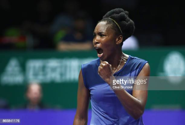 Venus Williams of the United States celebrates victory in her singles match against Jelena Ostapenko of Latvia during day 3 of the BNP Paribas WTA...