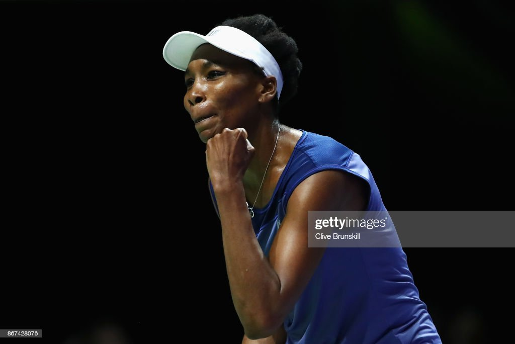 Venus Williams of the United States celebrates victory in her singles semi final match against Caroline Garcia of France during day 7 of the BNP Paribas WTA Finals Singapore presented by SC Global at Singapore Sports Hub on October 28, 2017 in Singapore.