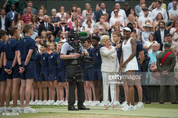 Venus Williams of The United States chats to Sue Barker of the BBC after defeat in the Ladies Singles final against Garbine Muguruza of Spain on day...