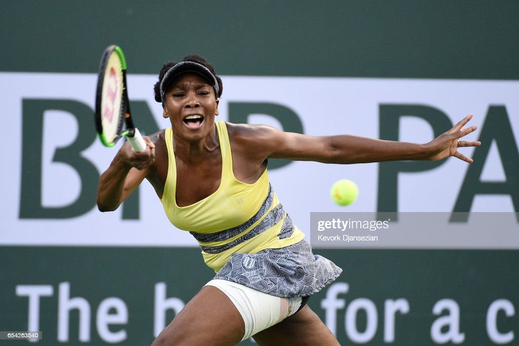 Venus Williams of the United States hits a forehand against Elena Vesnina of Russia in the Women's Singles quarterfinal match on Day 11 of the BNP Paribas Open at Indian Wells Tennis Garden on March 16, 2017 in Indian Wells, California.