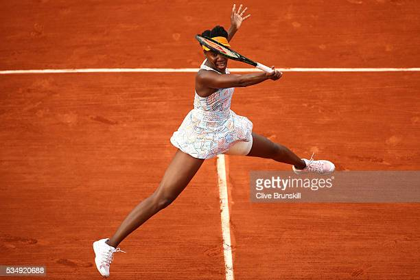 Venus Williams of the United States hits a forehand during the Ladies Singles third round match against Alize Cornet of France on day seven of the...