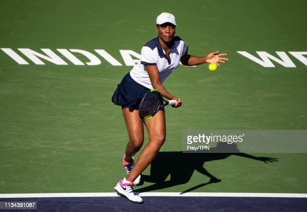 Venus Williams of the United States hits a forehand to Andrea Petkovic of Germany in the first round BNP Paribas Open at the Indian Wells Tennis...