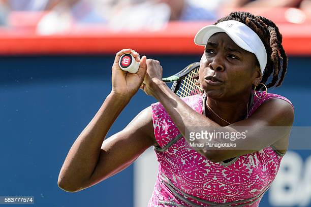Venus Williams of the United States hits a return against Barbora Strycova of Czech Republic during day three of the Rogers Cup at Uniprix Stadium on...