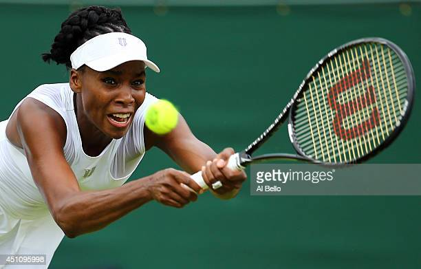 Venus Williams of the United States in action during her Ladies' Singles first round match against Maria-Teresa Torro-Flor of Spain on day one of the...