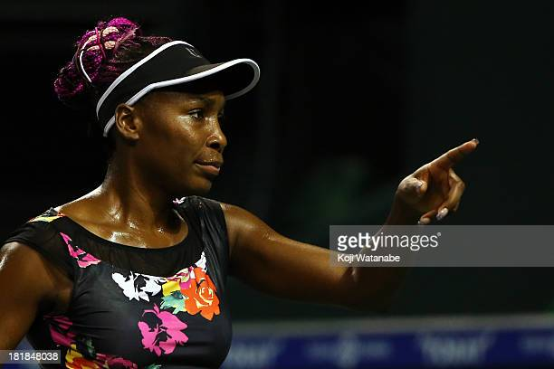 Venus Williams of the United States in action during her women's singles quarter final match against Eugenie Bouchard of Canada during day five of...