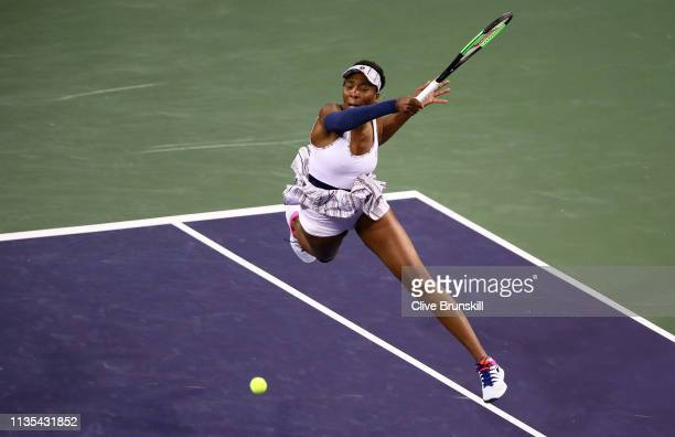 Venus Williams of the United States leaps into the air to play a forehand against Mona Barthel of Germany during their women's singles fourth round...