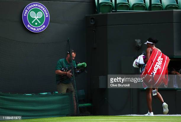 Venus Williams of The United States leaves the court following defeat in her Ladies' Singles first round match against Cori Gauff of the United...