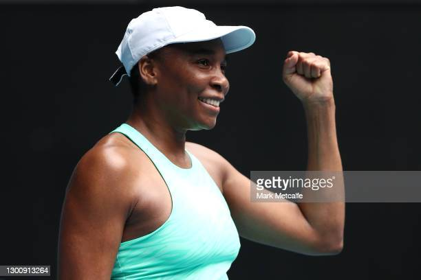 Venus Williams of The United States of America celebrates after winning match point in her Women's Singles first round match against Kirsten Flipkens...