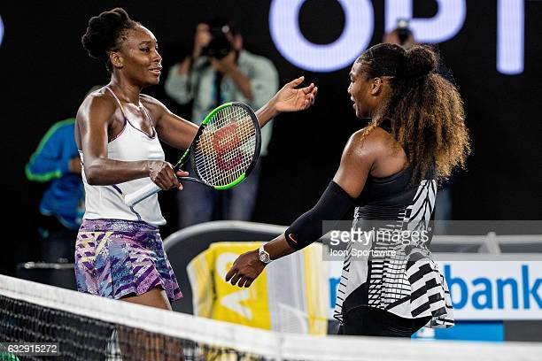 Venus Williams of the United States of America congratulates her sister Serena Williams of the United States of America on her winning the Womens...